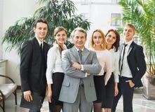 Geschäftsmann und erfolgreiches Geschäftsteam Lizenzfreies Stockbild