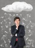 Geschäftsmann und Fragezeichen Stockbilder