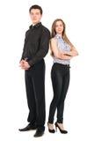 Geschäftsmann- und Frauenstellung lokalisiert auf weißem Hintergrund Lizenzfreie Stockfotos