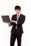 Geschäftsmann und Laptop. Stockbild