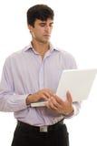 Geschäftsmann und Laptop Lizenzfreies Stockbild