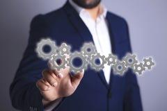 Geschäftsmann und Mechanismus lizenzfreie abbildung