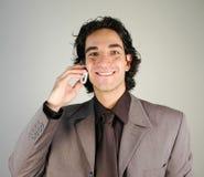 Geschäftsmann und Mobiltelefon lizenzfreie stockbilder