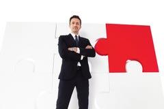 Geschäftsmann und Puzzlespiel Stockfotos