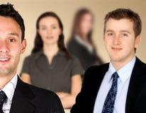 Geschäftsmann und sein Team Stockbilder