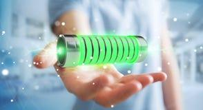 Geschäftsmann unter Verwendung der grünen Batterie mit Wiedergabe der Blitze 3D Lizenzfreie Stockfotografie