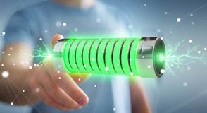 Geschäftsmann unter Verwendung der grünen Batterie mit Wiedergabe der Blitze 3D Lizenzfreies Stockfoto