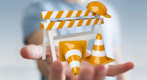 Geschäftsmann unter Verwendung digitalen 3D, das im Bau Zeichen überträgt Lizenzfreies Stockfoto