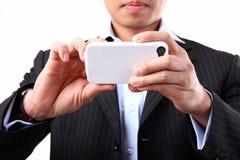 Geschäftsmann unter Verwendung einer beweglichen Kamera Lizenzfreies Stockfoto