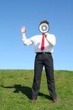 Geschäftsmann unter Verwendung eines Megaphons stockfotografie
