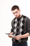 Geschäftsmann unter Verwendung seiner Tablette Stockbild