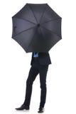 Geschäftsmann versteckt sein Gesicht mit Regenschirm Lizenzfreies Stockbild