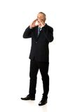 Geschäftsmann in voller Länge, der jemand fordert Lizenzfreie Stockbilder