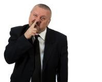 Geschäftsmann wählt Nase aus lizenzfreies stockfoto