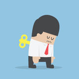 Geschäftsmann-With-Wind--obenschlüssel in seinem zurück Stockfoto