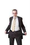 Geschäftsmann zeigt leere Taschen Stockfoto