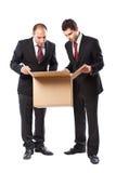 Geschäftsmann zwei, der innerhalb eines Kastens schaut Lizenzfreie Stockfotos