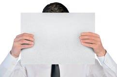 Geschäftsmannabdeckung durch leeres Brett Lizenzfreie Stockfotografie