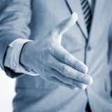 Geschäftsmannangebot-Handerschütterung Stockfotos