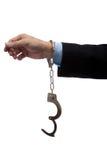 Geschäftsmannarm in den Handschellen Stockfotografie