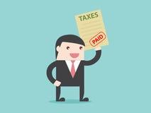 Geschäftsmannbezahlte steuern Stockfotos