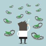 Geschäftsmannblick auf Geld auf Falle Stockfotos