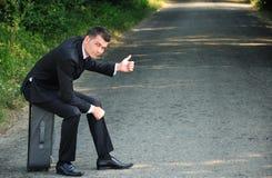 Geschäftsmanndaumen eine Fahrt Stockfotografie