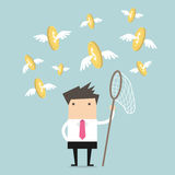 Geschäftsmannfang-Fliegenmünzen Stockfoto