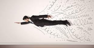 Geschäftsmannfliegen mit der gezeichneten Hand zeichnet herauskommen Stockfotografie