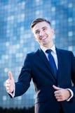 Geschäftsmanngruß mit jemand Stockfoto