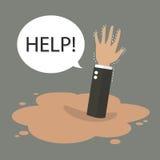 Geschäftsmannhand, die in eine Pfütze von Treibsand sinkt Stockbild