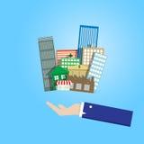 Geschäftsmannhand, die Gruppe von Immobilien hält Lizenzfreie Stockfotografie