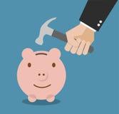 Geschäftsmannhand, die Sparschwein bricht Stockbild