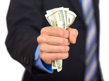 Geschäftsmannhand-Ergreifungsgeld Lizenzfreie Stockfotografie