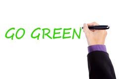 Geschäftsmannhand schreibt gehen grüner Text Lizenzfreie Stockfotografie