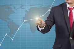 Geschäftsmannhandrührendes Diagramm Lizenzfreie Stockfotografie