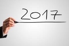 Geschäftsmannhandschrift das Datum 2017 Stockfotos