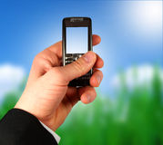 Geschäftsmannholding-Handy Stockfoto
