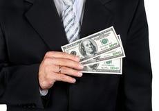 Geschäftsmannholdingdollar Stockfoto