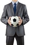 Geschäftsmannholdingfußball Stockfotos