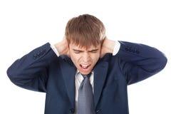 Geschäftsmannholdinghände auf seinen Ohren Stockbilder