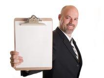 Geschäftsmannholdingklemmbrett Lizenzfreies Stockbild
