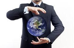 Geschäftsmannholdingkugel Lizenzfreies Stockfoto
