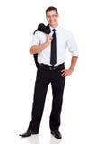 Geschäftsmannjacke auf Schulter Stockfotos