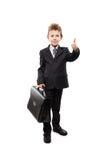 Geschäftsmannkinderjunge, der den Aktenkoffer gestikuliert Daumen herauf Erfolgszeichen hält Stockbild