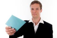Geschäftsmannlächeln mit einem blauen Zeichen in seiner Hand Stockbilder
