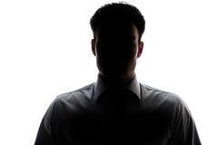 Geschäftsmannporträtschattenbild, das ein Hemd und eine Bindung trägt Stockfotos