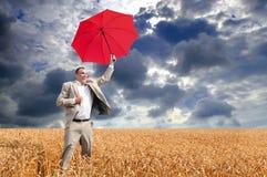 Geschäftsmannregenschirm lizenzfreies stockfoto