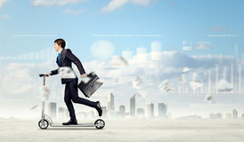 Geschäftsmannreitroller Lizenzfreies Stockfoto