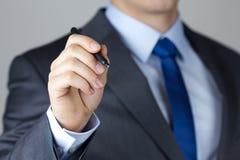 Geschäftsmannschreiben etwas Lizenzfreies Stockbild
